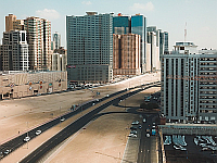 city with highway and skyscraper