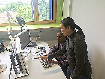 2 Fellows look at a PC screen together